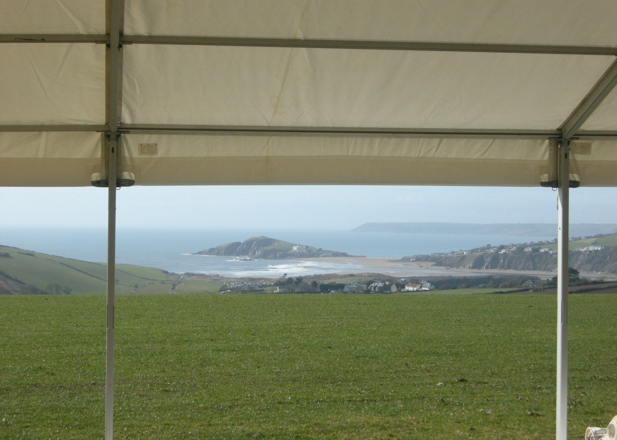 View of Burgh Island from marquee at Bantham Bash wedding site, Thurlestone, Devon