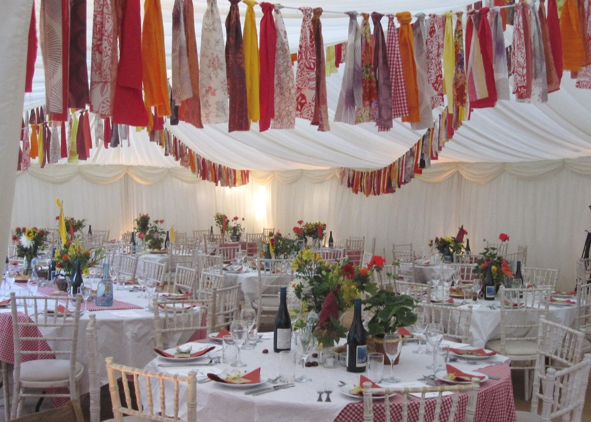 Interior view of marquee with nepalese-inspired prayer flag bunting