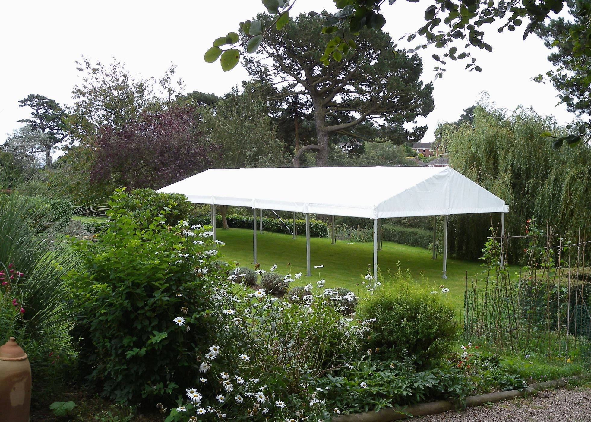 View of 6m x 15m clearspan marquee, roof-only, in garden