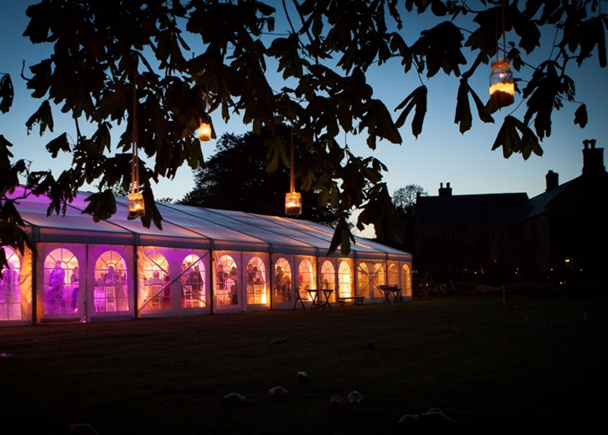 Exterior view of Wedding Marquee at Sheafhayne Manor in East Devon lit at night