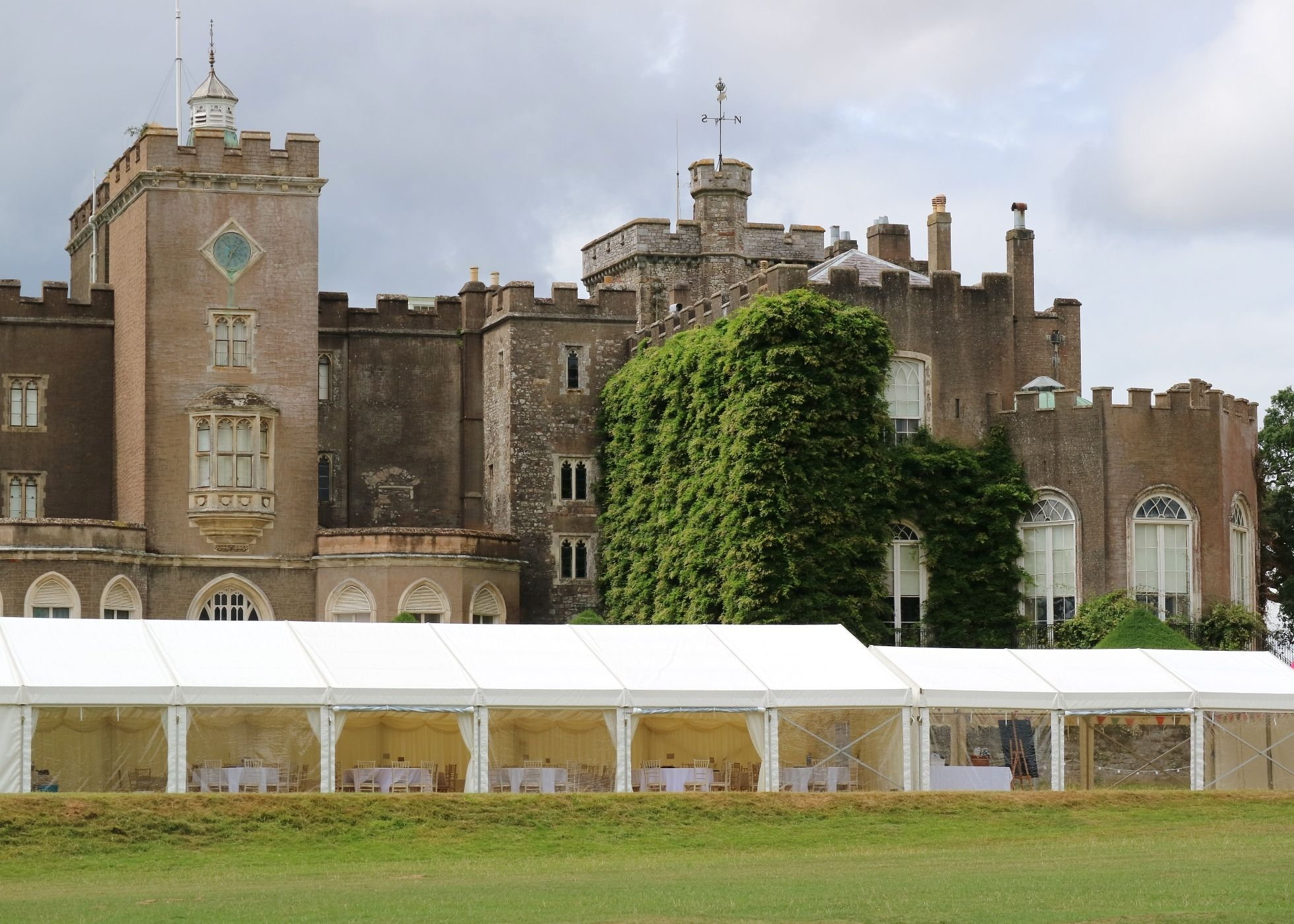 exterior view of marquee with Powderham Castle in the background